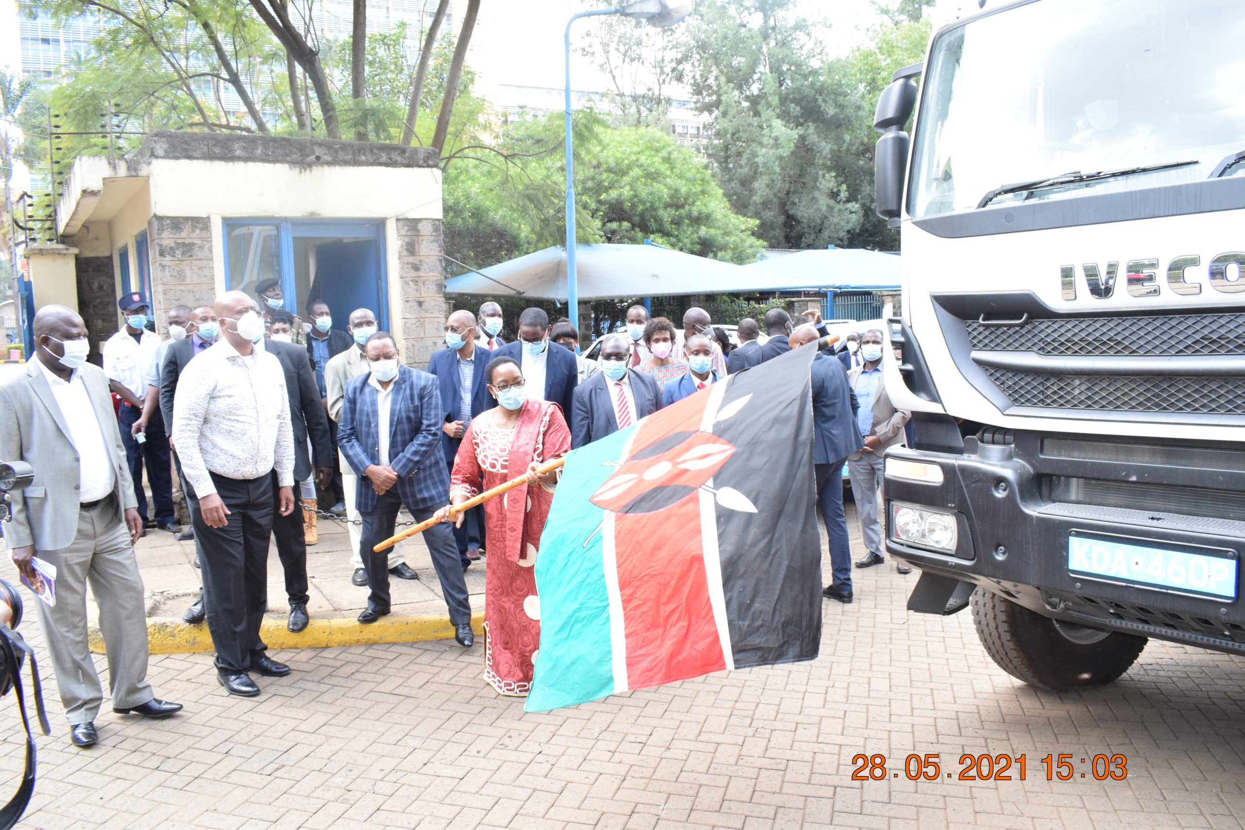 Water and Sanitation and Irrigation Cabinet Secretary , Sicily Kariuki , flags off  sewer flushing units and operation vehicles for the  Company at Maji House. She is flanked by Water Principal Secretary Joseph Irungu ( 3rd Left) and Nairobi Metropolitan Services (NMS)  Director General Major General Mohammed Badi (2nd Left) and other top state  officials .  Three flushing units and  five operational  vehicles were handed over to the  Company  at the event.